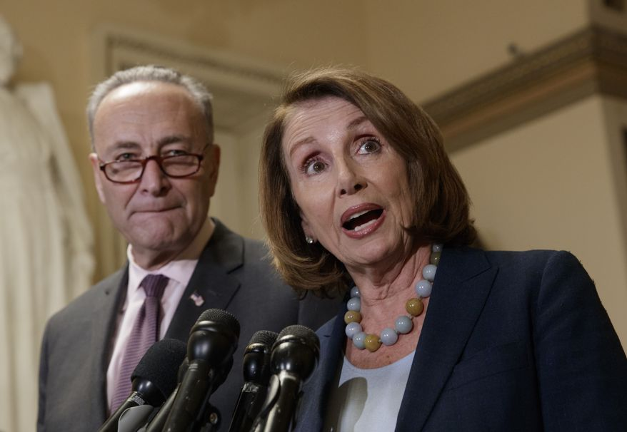 In this March 13, 2017, file photo, House Minority Leader Nancy Pelosi of Calif., accompanied by Senate Minority Leader Charles Schumer of N.Y., speaks to reporters on Capitol Hill in Washington. (AP Photo/J. Scott Applewhite, File)