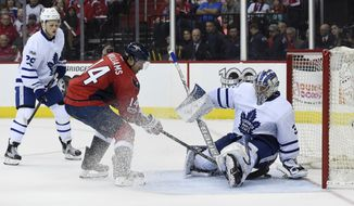 Washington Capitals right wing Justin Williams (14) scores against Washington Capitals goalie Philipp Grubauer (31) in front of center William Nylander (29) during the second period in Game 1 of an NHL Stanley Cup first round playoff series in Washington, Thursday, April 13, 2017. (AP Photo/Molly Riley)