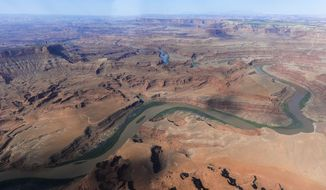 This May 23, 2016, file photo, shows the northernmost boundary of the proposed Bears Ears region, along the Colorado River, in southeastern Utah. Western Democrats are pressuring President Donald Trump not to rescind land protections put in place by President Barack Obama, including Utah's Bears Ears National Monument. Obama infuriated Utah Republicans when he created the monument on 1.3 million acres of land that is sacred to Native Americans. (Francisco Kjolseth/The Salt Lake Tribune via AP, File)