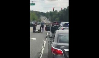 Gwinnett County Police Officer Robert McDonald has been fired after a now-viral video showed him stomping a handcuffed suspect's head during a traffic stop Wednesday afternoon. (Facebook/@Black Lives Matter of Greater Atlanta)