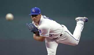 Kansas City Royals starting pitcher Jason Vargasp throws during the first inning of a baseball game against the Oakland Athletics Thursday, April 13, 2017, in Kansas City, Mo. (AP Photo/Charlie Riedel)