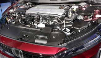 The fuel cell engine of the Honda Clarity is shown during a media preview at the New York International Auto Show, at the Jacob Javits Center in New York, Wednesday, April 12, 2017. (AP Photo/Richard Drew)