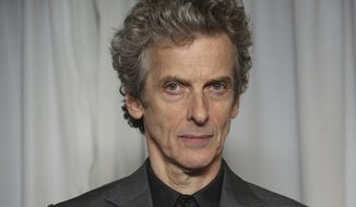 """FILE - This is a Sunday, 29 March, 2015   file photo of British actor Peter Capaldi as he poses for photographers upon arrival for the 20th Jameson Empire Film Awards at the Grosvenor Hotel in central London. After three seasons of zooming through space and time, Peter Capaldi is preparing to hang up his sonic screwdriver and depart """"Doctor Who."""" (Photo by Joel Ryan/Invision/AP, File)"""
