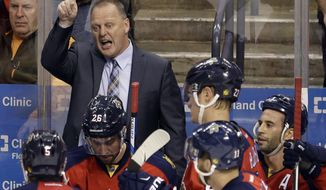 FILE - In this April 14, 2016, file photo, Florida Panthers coach Gerard Gallant talks to the players during a timeout in the third period of Game 1 in a first-round NHL hockey Stanley Cup playoff series against the New York Islanders, in Sunrise, Fla. The Vegas Golden Knights have hired Gerard Gallant as the first coach of the NHL expansion team. General manager George McPhee announced the move Thursday, April 13, 2017.(AP Photo/Alan Diaz, File)