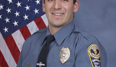 In this undated Gwinnett County Police Department photo, Master Police Officer Robert McDonald poses for an official portrait. McDonald, has been terminated and is under investigation after authorities say he kicked a handcuffed Demetrius Bryan Hollins in the head during a traffic stop, according to the Police department. (Gwinnett County Police Department via AP)