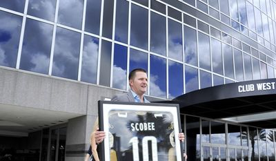 Retired Jacksonville Jaguars' kicker Josh Scobee leaves EverBank Field carrying his framed team jersey Thursday, April 13, 2017, in Jacksonville, Fla. (Bruce Lipsky/The Florida Times-Union via AP)