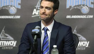 FILE - In this Feb. 5, 2015, file photo, Orlando Magic general manager Rob Hennigan pauses to answer a question during a news conference in Orlando, Fla. The Orlando Magic have fired general manager Rob Hennigan after missing the postseason for five straight seasons. The team confirmed the dismissal on Thursday, April 13, 2017. (Stephen M. Dowell/Orlando Sentinel via AP, File)