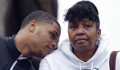 Michigan State's Miles Bridges, left, talks with his mother, Cynthia, during an NCAA college basketball news conference, Thursday, April 13, 2017, in East Lansing, Mich. Bridges, a 6-foot-7 forward from Flint, Mich., announced he is returning for his sophomore season. (AP Photo/Al Goldis)