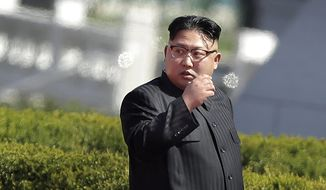North Korean leader Kim Jong-n arrives for the official opening of the Ryomyong residential area, on Thursday, April 13, 2017, in Pyongyang, North Korea. Japan's Prime Minister Shinzo Abe, speaking Thursday at a parliamentary panel on national security and diplomacy, warned that North Korea may be capable of firing a missile loaded with sarin nerve gas toward Japan. (AP Photo/Wong Maye-E)