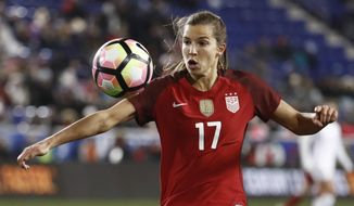 FILE--In this March 4, 2017, file photo, United States midfielder Tobin Heath eyes the ball against England during the second half of a SheBelieves Cup women's soccer match in Harrison, N.J. While a few of the U.S. women's national team players have opted to go overseas, Heath is happy to stay stateside with the Portland Thorns. (AP Photo/Julio Cortez, file)