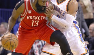 FILE - In this Dec. 9, 2016, file photo, Houston Rockets guard James Harden (13) is defended by Oklahoma City Thunder guard Russell Westbrook (0) on a drive to the basket during the second half of an NBA basketball game in Oklahoma City. The playoffs start Saturday, with a series matching MVP candidates Russell Westbrook and James Harden the highlight of the first round. (AP Photo/Alonzo Adams, File)