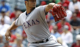 Texas Rangers starting pitcher Yu Darvish throws to the plate against the Los Angeles Angels during the first inning of a baseball game in Anaheim, Calif., Thursday, April 13, 2017. (AP Photo/Alex Gallardo)