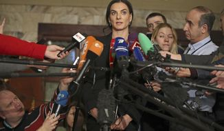 """FILE - In this Friday, Dec. 9, 2016 file photo, former Russian pole vaulter Yelena Isinbayeva speaks to the media in Moscow, Russia. The IAAF says Russia is making """"little progress"""" cleaning up its doping culture to secure its reinstatement into athletics. In a report on Thursday April 13, 2017, the athletics governing body criticizes Russia's decision to make pole vault great Yelena Isinbayeva the head of the country's scandalized anti-doping agency. (AP Photo/Pavel Golovkin, File)"""