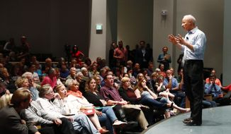 U.S. Rep. Mike Coffman, R-Colo., addresses constituents during a town hall meeting in a hall on the campus of the University of Colorado Medical School late Wednesday, April 12, 2017, in Aurora, Colo. (AP Photo/David Zalubowski)