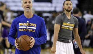 Golden State Warriors assistant coach Bruce Fraser, left, and guard Stephen Curry look toward the basket during warmups before the team's NBA basketball game against the Los Angeles Lakers on Wednesday, April 12, 2017, in Oakland, Calif. Curry and Kevin Durant took turns firing 3-pointer after 3-pointer, some 200 of them total, all while their coaches-turned-rebounders kept careful count of their makes and misses in an entertaining post-practice show.(AP Photo/Marcio Jose Sanchez)