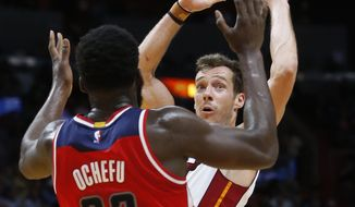 Miami Heat guard Goran Dragic looks for an opening past Washington Wizards forward Daniel Ochefu (32) during the second half of an NBA basketball game, Wednesday, April 12, 2017, in Miami. (AP Photo/Wilfredo Lee)