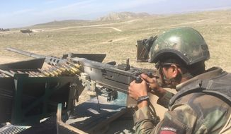 An Afghan commando mans a machine gun at the Pandola village near the site of the U.S. forces' bombing in Achin district of Jalalabad, east of Kabul, Afghanistan, Friday, April 14, 2017. U.S. forces in Afghanistan on Thursday struck an Islamic State tunnel complex in eastern Afghanistan with  the largest non-nuclear weapon every used in combat by the U.S. military, Pentagon officials said. (AP Photo/Rahmat Gul)