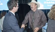 FILE - In this March 18, 2017 file photo, Congressional candidate Rob Quist meets with supporters during the annual Mansfield Metcalf Celebration dinner hosted by the state's Democratic Party in Helena, Montana. He is trying to fire up the party faithful in his race against Republican Greg Gianforte in a May 25 special election to fill Montana's sole congressional seat. (AP Photo/Bobby Caina Calvan, File)