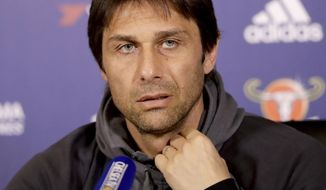 FILE - In this file photo dated Tuesday, April 4, 2017, Chelsea's manager Antonio Conte gives a press conference at their training facilities in Stoke d'Abernon, on the outskirts of London.  Conte remembers when he was a soccer player and scored a goal against Manchester United in 1999, he recounts Friday April 14, 2017, and now as a manager will lead Chelsea into an English Premier League soccer match against Manchester United on upcoming Sunday.  (AP Photo/Matt Dunham, FILE)
