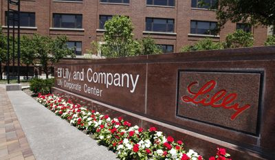 FILE - This Thursday, June 30, 2011, file photo shows a sign in front of the Eli Lilly and Company corporate headquarters in Indianapolis. On Friday, April 14, 2017, Eli Lilly said U.S. regulators have rejected its much-anticipated pill for the immune disorder rheumatoid arthritis, the drugmaker's second drug development setback since November 2016. (AP Photo/Darron Cummings, File)