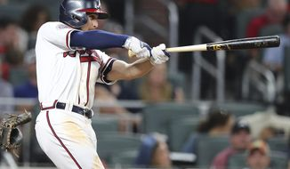 Atlanta Braves' Ender Inciarte hits the first home run for 2-RBIs in SunTrust Park for a lead over the San Diego Padres during the sixth inning in the Braves' home opener on Friday, April 14, 2017, in Atlanta. (Curtis Compton/Atlanta Journal-Constitution via AP)