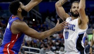 Orlando Magic's Evan Fournier (10) looks to pass the ball as Detroit Pistons' Andre Drummond defends during the second half of an NBA basketball game, Wednesday, April 12, 2017, in Orlando, Fla. Orlando won 113-109. (AP Photo/John Raoux)