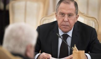 Russian Foreign Minister Sergey Lavrov listens to his Syrian counterpart Walid Muallem during their meeting in Moscow, Russia, on Thursday, April 13, 2017.   Lavrov said he expected the OPCW ( Organization for the Prohibition of Chemical Weapons ) to conduct an extensive probe into the suspected nerve gas attack on Khan Sheikhoun, Syria, which could produce a report  within about three weeks, the British delegation to the commission said Thursday. (AP Photo/Pavel Golovkin)