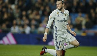 FILE - In this file photo dated Wednesday March 1, 2017, Real Madrid's Gareth Bale reacts during a Spanish La Liga soccer match between Real Madrid and Las Palmas at the Santiago Bernabeu stadium in Madrid, Spain.  Real Madrid will have to continue its push toward its first Spanish league title in five years without the injured Gareth Bale, after Coach Zidane Zidane confirmed Friday April 14, 2017, a leg injury will stop Bale playing upcoming Saturday. (AP Photo/Paul White, FILE)