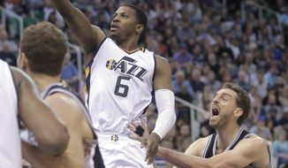 Utah Jazz forward Joe Johnson (6) lays the ball up as San Antonio Spurs center Pau Gasol (16) defends during the second half of an NBA basketball game Wednesday, April 12, 2017, in Salt Lake City. The Jazz won 101-97. (AP Photo/Rick Bowmer)