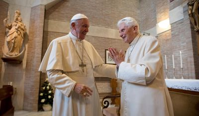 "FILE - In this Saturday, Nov. 19, 2016 filer, Pope Francis, left, talks with Pope Emeritus Benedict XVI in the former Convent Mater Ecclesiae at the Vatican. A ""modest"" 90th birthday party is being planned for Benedict XVI, who stunned the Catholic church by resigning in 2013. His aide, Monsignor Georg Gaenswein, says Benedict's birthday, which falls on Easter Sunday this year, will be celebrated on Monday in Bavarian style in keeping with the emeritus pontiff's roots. (L'Osservatore Romano/Pool Photo via AP)"