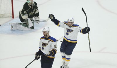 St. Louis Blues' David Perron (57) and Alex Pietrangelo (27) celebrate after their team scored the winning goal against the Minnesota Wild during the third period of Game 2 of an NHL hockey first-round playoff series Friday, April 14, 2017, in St. Paul, Minn. (AP Photo/Stacy Bengs)