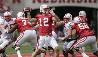 Nebraska Red quarterback Patrick O'Brien (12) throws during the annual NCAA college football Red-White spring game in Lincoln, Neb., Saturday, April 15, 2017. (AP Photo/Nati Harnik)