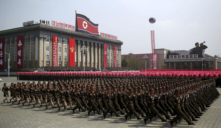 Soldiers march across Kim Il Sung Square during a military parade on Saturday, April 15, 2017, in Pyongyang, North Korea to celebrate the 105th birth anniversary of Kim Il Sung, the country's late founder and grandfather of current ruler Kim Jong Un. (AP Photo/Wong Maye-E)
