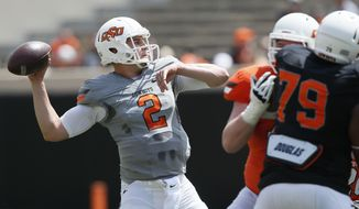 Oklahoma State quarterback Mason Rudolph (2) passes during an intra squad spring NCAA college football game in Stillwater, Okla., Saturday, April 15, 2017. (AP Photo/Sue Ogrocki)