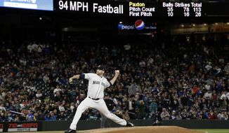 Seattle Mariners starting pitcher James Paxton throws his final pitch of the night as he strikes out Texas Rangers' Joey Gallo during the eighth inning of a baseball game Saturday, April 15, 2017, in Seattle. (AP Photo/Elaine Thompson)