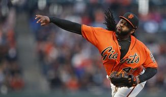 San Francisco Giants pitcher Johnny Cueto throws to the Colorado Rockies during the first inning of a baseball game, Friday, April 14, 2017, in San Francisco. (AP Photo/Tony Avelar)