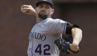 Colorado Rockies pitcher Tyler Chatwood, wearing No. 42 in tribute to Jackie Robinson, throws against the San Francisco Giants during the first inning of a baseball game in San Francisco, Saturday, April 15, 2017. (AP Photo/Jeff Chiu)