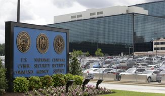 FILE - This June 6, 2013, file photo, shows the National Security Agency (NSA) campus in Fort Meade, Md., where the U.S. Cyber Command is located. The American military services are looking for new ways to bring in more civilians with high-tech skills who can help fight Islamic State militants and prepare for the new range of technological threats the U.S. will face. (AP Photo/Patrick Semansky, File)