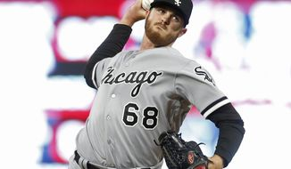 Chicago White Sox pitcher Dylan Covey throws against the Minnesota Twins as he makes his major league debut, in the first inning of a baseball game Friday, April 14, 2017, in Minneapolis. (AP Photo/Jim Mone)
