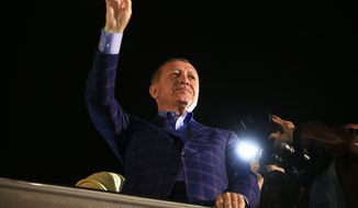 """Turkey's President Recep Tayyip Erdogan waves to supporters in Istanbul, Turkey, on Sunday, April 16, 2017. Erdogan declared victory in Sunday's historic referendum that will grant sweeping powers to the presidency, hailing the result as a """"historic decision."""" (AP Photo/Lefteris Pitarakis)"""