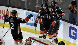 Anaheim Ducks celebrate center Rickard Rakell's goal against the Calgary Flames during the first period in Game 2 of a first-round NHL hockey Stanley Cup playoff series in Anaheim, Calif., Saturday, April 15, 2017. (AP Photo/Chris Carlson)