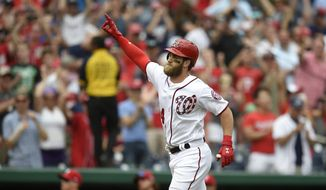 Washington Nationals' Bryce Harper gestures as he trots home after he hit a three-run walkoff home run during the ninth inning of a baseball game against the Philadelphia Phillies, Sunday, April 16, 2017, in Washington. The Nationals won 6-4. (AP Photo/Nick Wass)
