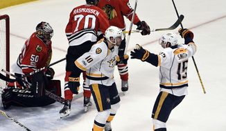 Nashville Predators center Colton Sissons (10) celebrates his goal against the Chicago Blackhawks with center Craig Smith (15) during the second period in Game 2 of a first-round NHL hockey playoff series, Saturday, April 15, 2017, in Chicago. (AP Photo/David Banks)