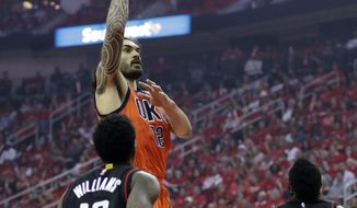 Oklahoma City Thunder's Steven Adams shoots against Houston Rockets' Lou Williams (12) and James Harden (13) during the first half of Game 1 of an NBA basketball first-round playoff series, Sunday, April 16, 2017, in Houston. (AP Photo/David J. Phillip)