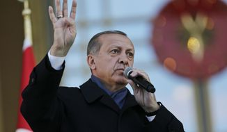 Turkey's President Recep Tayyip Erdogan, delivers a speech during a rally of supporters a day after the referendum, outside the Presidential Palace, in Ankara, Turkey, Monday, April 17, 2017. Turkey's main opposition party urged the country's electoral board Monday to cancel the results of a landmark referendum that granted sweeping new powers to Erdogan, citing what it called substantial voting irregularities. (AP Photo/Burhan Ozbilici)