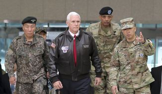 """U.S. Vice President Mike Pence arrives with U.S. Gen. Vincent Brooks, second from right, commander of the United Nations Command, U.S. Forces Korea and Combined Forces Command, and South Korean Deputy Commander of the Combined Force Command Gen. Leem Ho-young, left, at the border village of Panmunjom in the Demilitarized Zone (DMZ) which has separated the two Koreas since the Korean War, South Korea, Monday, April 17, 2017. Viewing his adversaries in the distance, Pence traveled to the tense zone dividing North and South Korea and warned Pyongyang that after years of testing the U.S. and South Korea with its nuclear ambitions, """"the era of strategic patience is over."""" (AP Photo/Lee Jin-man)"""