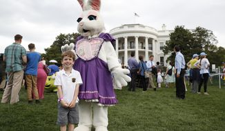 Michael McGee, 5, poses with an Easter bunny during the White House Easter Egg Roll on the South Lawn of the White House in Washington, Monday, April,17, 2017. President Donald Trump and first lady Melania Trump are set to host the official annual Easter egg roll at the White House.(AP Photo/Carolyn Kaster)