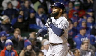 Milwaukee Brewers' Eric Thames celebrates his home run off Chicago Cubs starting pitcher John Lackey, during the third inning of a baseball game Monday, April 17, 2017, in Chicago. (AP Photo/Charles Rex Arbogast)