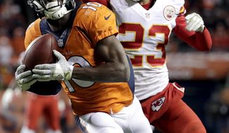 """FILE - In this Nov. 27, 2016, file photo, Denver Broncos wide receiver Emmanuel Sanders (10) pulls in a touchdown pass as Kansas City Chiefs cornerback Phillip Gaines (23) defends during the second half of an NFL football game, in Denver. Sanders called Denver """"wide receiver heaven"""" back when he joined the Broncos in 2014. He's counting on Mike McCoy bringing back nirvana to the Mile High City in 2017. (AP Photo/Jack Dempsey, File)"""