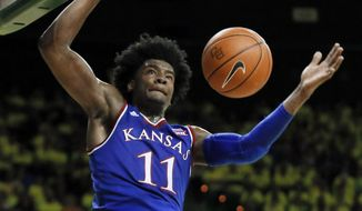 FILE - In this Feb. 18, 2017, file photo, Kansas guard Josh Jackson (11) dunks against Baylor in the first half of an NCAA college basketball game, in Waco, Texas. Kansas freshman Josh Jackson has announced he will enter the NBA draft. Jackson, who released a statement on Monday, April 17, 2017, was the Big 12 Newcomer of the Year after averaging 16.3 points and 7.4 rebounds per game.(AP Photo/Tony Gutierrez, File)